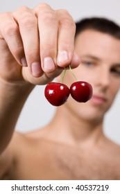 Man hold cherry