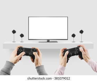 Man hold gamepad in hands in front of blank tv screen mock up playing game. Clear monitor mockup with gamer first person. Men play video games on console station. People gaming contest. Two players.