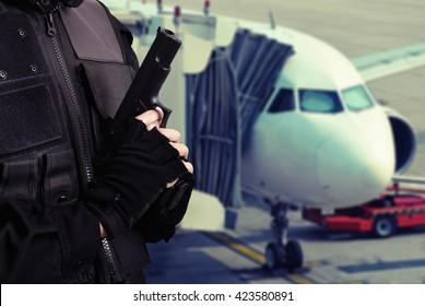 man hold gun , terrorism on plane concept background