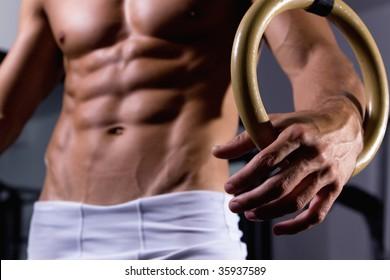 Man hold gymnastic ring