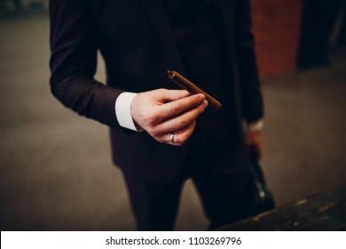 Man hold Handmade luxury Cigar in hand