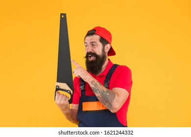 Man hold handsaw in hand. Carpentry works. Repair wooden objects. Carpentry service. Carpentry workshop concept. Professional tools. Builder worker carpenter handyman hold saw. Safety measures.