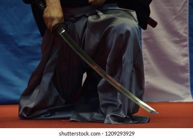 Man hold katana