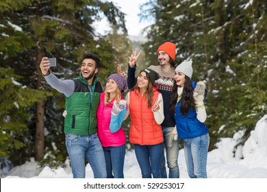 Man Hold Smart Phone Camera Taking Selfie Photo Snow Forest Young People Group Outdoor Winter Pine Woods