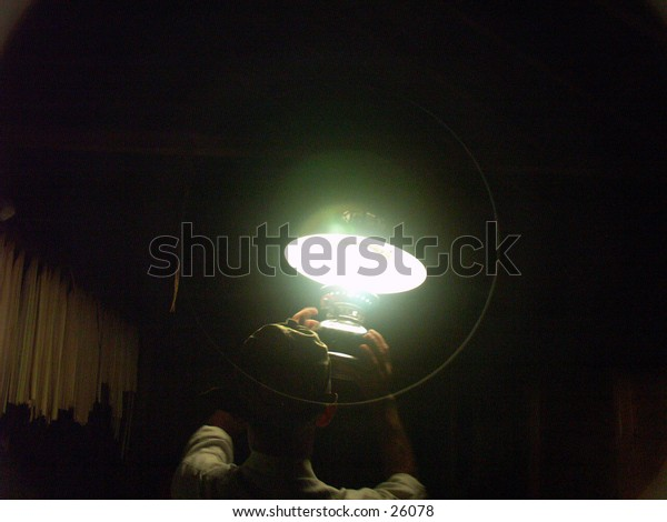 A man hold the traditional lamp