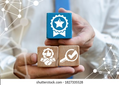 Man hold wooden cubes with award or seal with star sign. Validation Uniqueness Quality Difference Guarantee Premium Concept. Choice Good product, choose warranty.