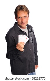 man holding a 4 of a kind shows his poker face