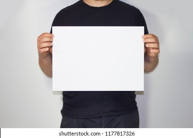 Man holding a A3 paper