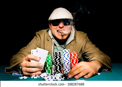 Man holding aces in his hand.Selective focus on the man head