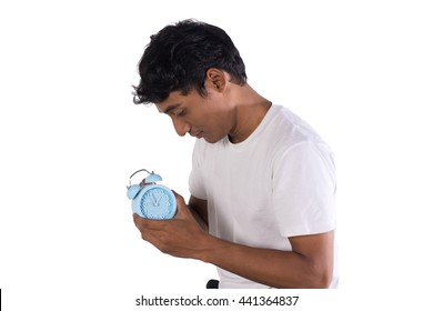 man holding the alarm clock. isolated