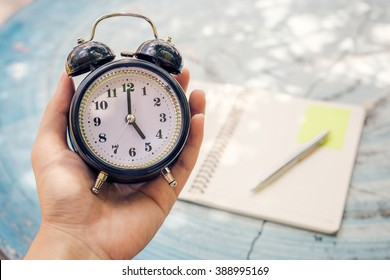 man holding alarm clock, Time Out,