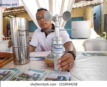 a man holding an anemometer is a wind speed measuring device that is widely used in the field of Meteorology and Geophysics or weather forecast stations, in Batang Indonesia, October 1, 2019