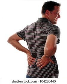 Man holding back because of lower back pain