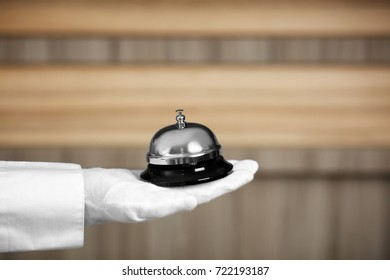 Man holding bell on blurred background