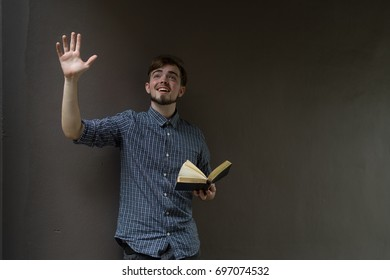 a man holding a bible and pray, believe concept