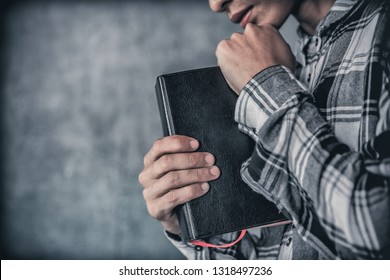 Man holding a bible and praying. christian concept.