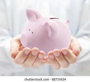Man holding big pink piggy bank