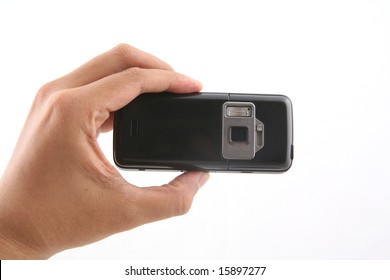 A man is holding a black cameraphone shot over white background