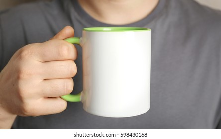 Man holding blank cup, closeup