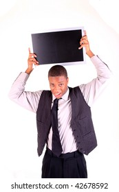 A man holding a blank monitor over his head