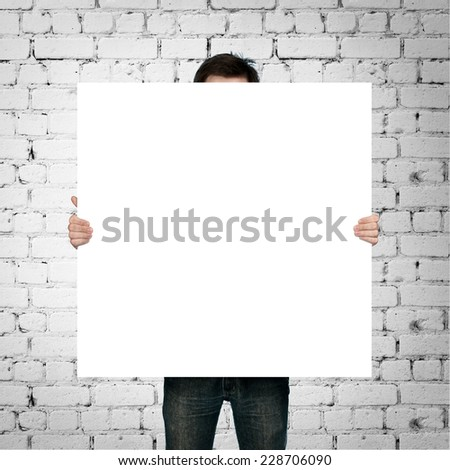 Man Holding Blank Paper On Brick Stock Photo Edit Now
