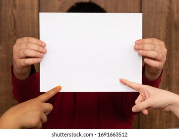 man holding blank paper with two people pointing