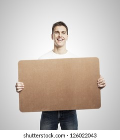 man holding blank poster on a white background