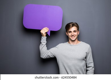Man holding blank speech bubble with space for text