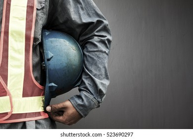 Man holding blue helmet close up