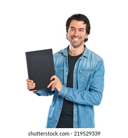 Man holding a book over white background