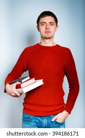 man holding books in his hands, isolated on a gray background