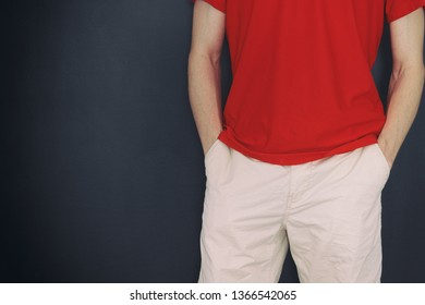 Man holding both hands in his pockets. Close up.