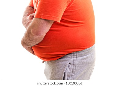 Man holding both hands on his aching stomach, closeup, over white background
