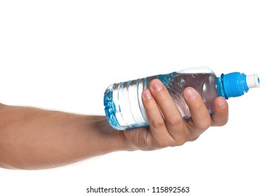 Man holding a bottle of water isolated on white background