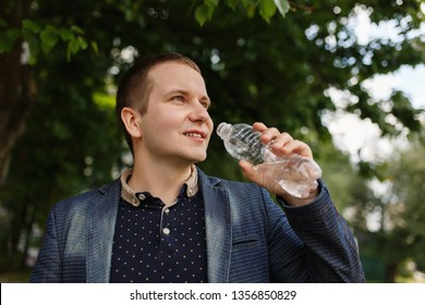 Man holding bottle with water on green ecology background