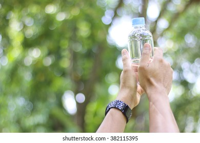 Man holding a bottle of water picture style soft focus