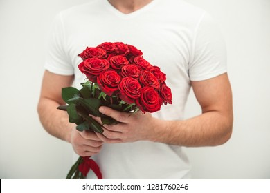 man holding bouquet of red roses, valentines day concept