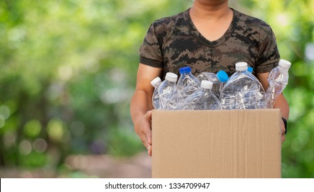 Man holding box paper with plastic bottle garbage for recycling concept reuse.copy space.