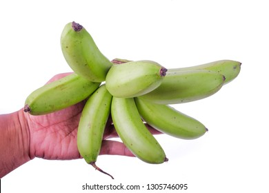 Man holding a bunch of green bananas isolated on white background