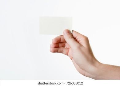 A man holding a business card
