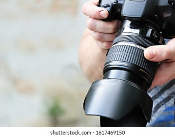 man holding camera  in a photograpy studio on white background stock photo