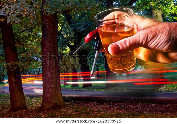Man Holding Car Key and Glass of Spirits