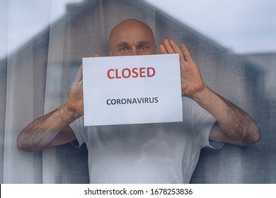 Man holding card shop closed due to coronavirus epidemic.