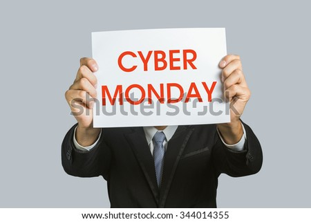 Man holding a card with the text Cyber Monday on white background