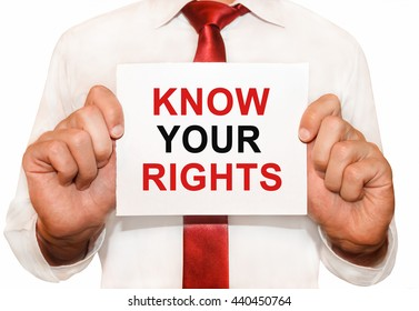 Man holding a card with a text Know Your Rights