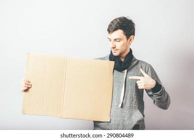 man holding a cardboard Inscription