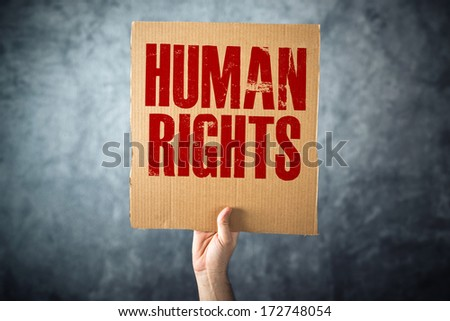 Man holding cardboard paper with HUMAN RIGHTS title, conceptual image