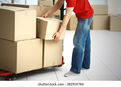 Man holding carton box in the room, close up