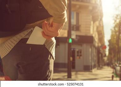 Man holding cellphone in pocket.