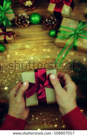 ce67af5e39 Man Holding Christmas Presents On Wooden Stock Photo (Edit Now ...